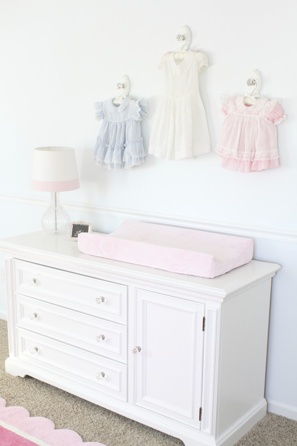 Antique Dresses above changing table