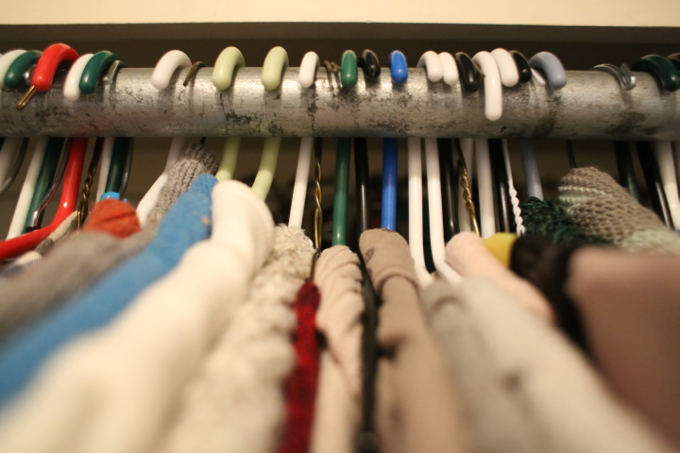 Turn your hangers backwards to tame clothing clutter